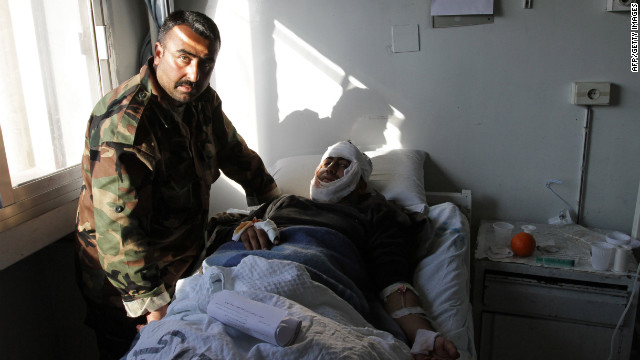A Syrian man who was wounded in a suicide attack rests at a hospital in<br />