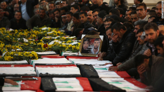 A day after the twin suicide bombings, Syrian mourners pray over the coffins of the 44 people killed during a mass f<br /> 1000<br /> uneral in Damascus.