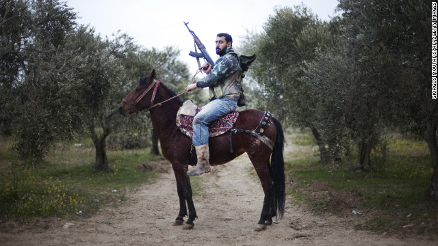 A Free Syrian Army rebel mounts his steed in the Al-Shatouria village near the Turkish border in northwestern Syria on March 16, a year after the uprising began. The Free Syrian Army is an armed opposition group made up largely of military defectors.