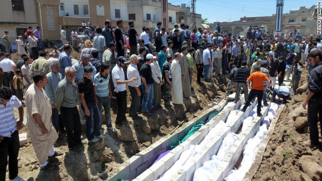 People gather at a mass burial on May 26 for victims reportedly killed during an artillery barrage from Syrian forces in Houla. The attack left at least 108 people dead, including nearly 50 children, according to the United Nations.