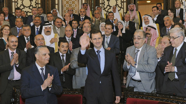 Syria's President Bashar al-Assad waves as he arrives for a speech to Syria's parliament in Damascus on June 3. The embattled president denied that government forces were behind the