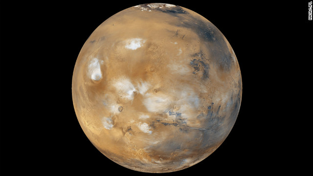 Water-ice clouds, polar ice and other geographic features can be seen in this full-disk image of Mars from 2011.