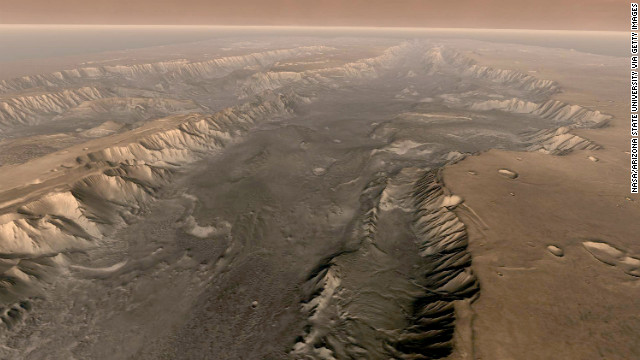 The Valles Marineris rift system on Mars is 10 times longer, five times deeper and 20 times wider than the Grand Canyon. This composite image was made aboard NASA's Mars Odyssey spacecraft, which launched in 2001.