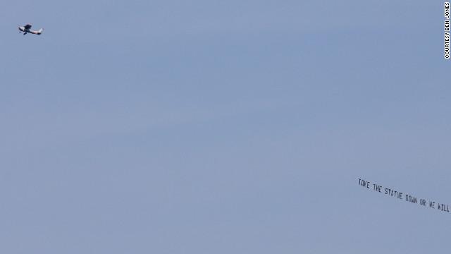 Airborne banner: Take down Paterno statue