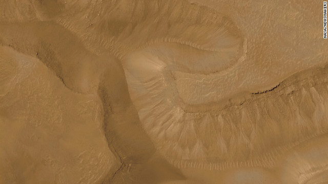Pictured is a series of troughs and layered mesas in the Gorgonum Chaos region of Mars in 2008. This photo was taken by Mars Orbiter Camera on the Mars Global Surveyor.