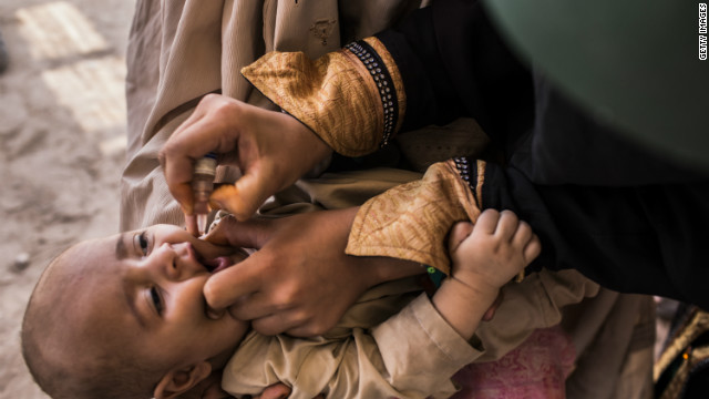 A three-month-old infant receives polio vaccination drops from his mother at a camp in Jalozai, Pakistan, in this picture taken July 13. 