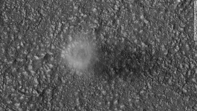 The Mars Reconnaissance Orbiter captures a dust devil blowing across the Martian surface east of the Hellas impact basin in 2007. Dust devils form when the temperature of the atmosphere near the ground is much warmer than that above. The diameter of this dust devil is about 200 meters (650 feet).