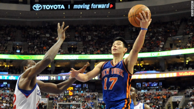 Jeremy Lin of the New York Knicks lays up a shot over Elton Brand of the Philadelphia 76ers in a March game in Philadelphia.