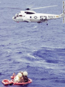 Astronaut Neil Armstrong was hoisted first into a hovering chopper, then Michael Collins, then Buzz Aldrin. Once aboard, the chopper headed for the USS Hornet. &quot;There was real delight on those astronauts' faces, and a real thrill of accomplishment,&quot; says Wolfram.