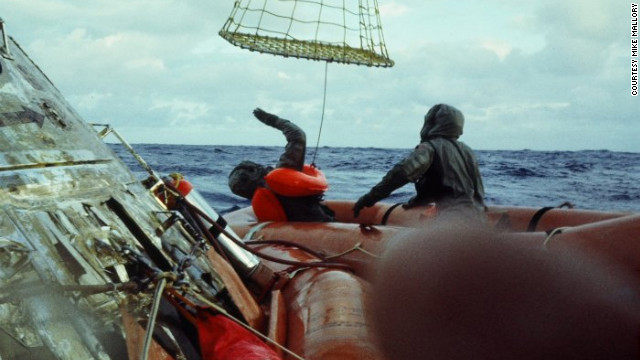 "Hatleberg helped the astronauts climb into a ""Billy-Pugh net"" which was used to hoist them into a Navy chopper hovering above."
