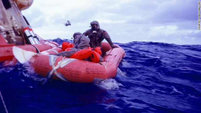 In the &quot;decontamination raft&quot; mission leader Clancy Hatleberg sprayed the astronauts with sodium hypochlorite and helped them scrub their suits. 