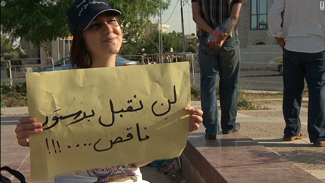 Rola Habashna, 17, is denied Jordanian citizenship despite having been born and bred in the country, because her father is Moroccan. She is protesting for her citizenship rights with a sign that reads: