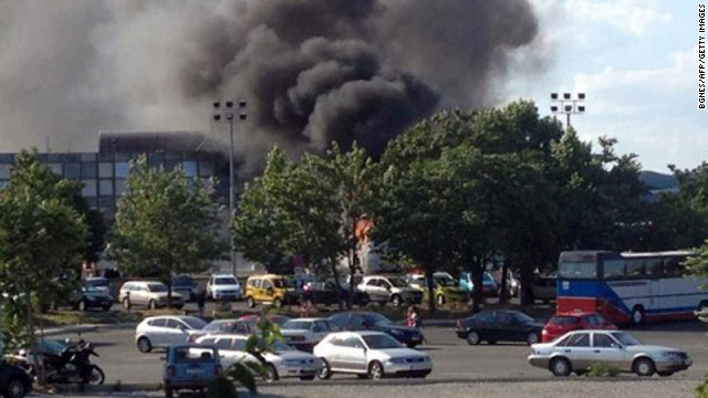 Smoke rises over Bulgaria's Burgas Airport after an explosion on a bus carrying Israeli tourists on Wednesday, July 18. At least six are dead.