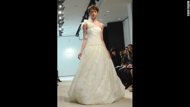 A model walks the runway in a one-shoulder gown at the Vera Wang Bridal Show in 2008 in New York City.
