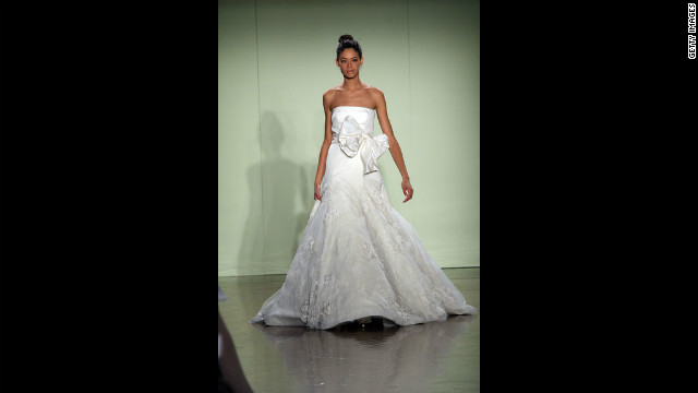 A model walks the runway wearing a strapless gown with large bow detail during the 2007 Vera Wang bridal collection show in New York City.