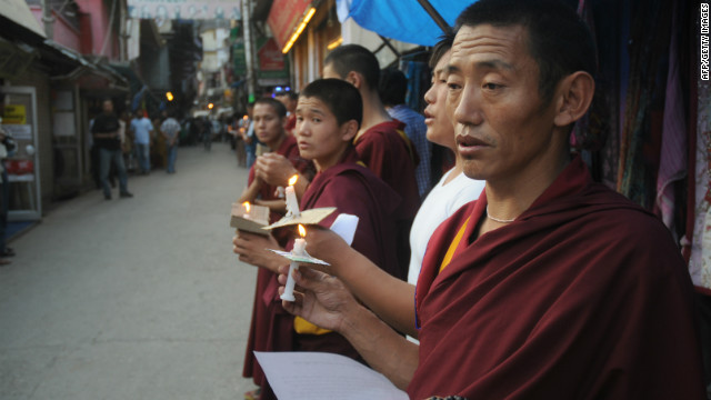 Exiled Tibetan monks chant prayers on June 15 after a man self-immolated in a Tibetan region of Qinghai province.