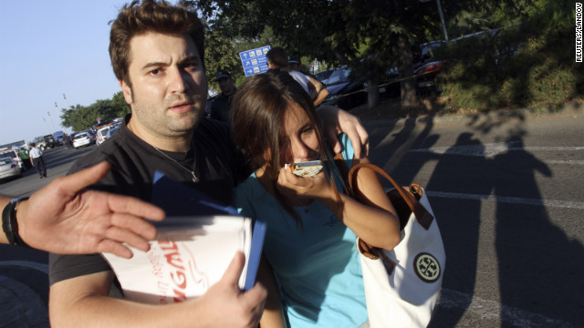 Bystanders react to the explosion. Key Israeli politicians have pointed to Iran as the likely instigator.
