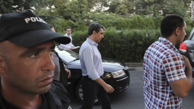 President Rosen Plevneliev, center, walks near the site of the explosion. Bulgaria will ask the U.N. Security Council to condemn the attack.