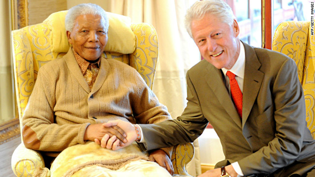 Nelson Mandela is congratulated on his 94th birthday in July by former U.S. President Bill Clinton in Cape Town, South Africa.