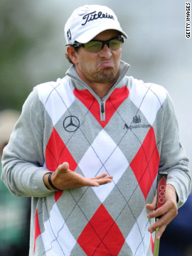 Scott, who leads the tournament after the first round with a 64, reacts to a shot Thursday.