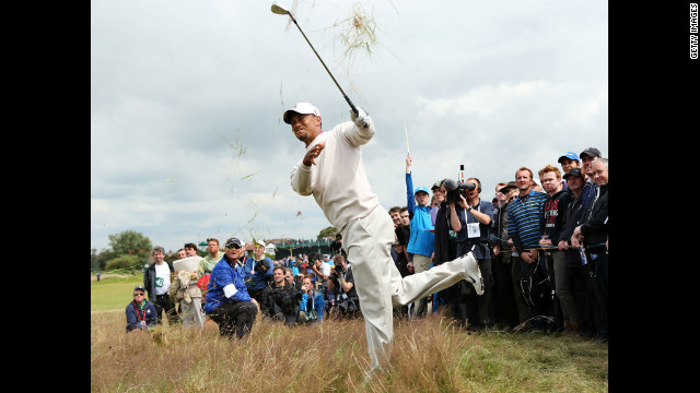 Tiger Woods makes a tough shot from the rough during the first round of the British Open on Thursday, July 19. Woods finished the Round 3 under par at 67. 