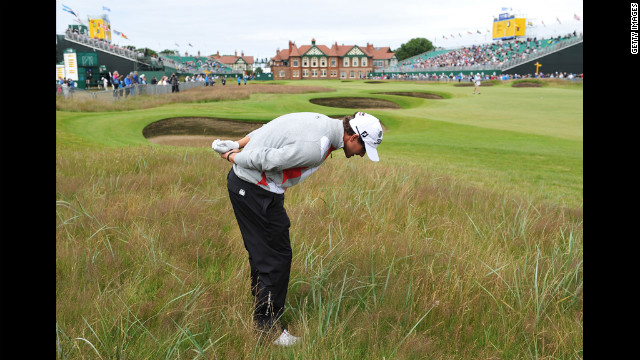 Scott looks at the lie of his ball in the deep rough on the 18th hole Thursday.