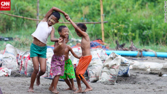 Regardless of the weather not cooperating, <a href='http://ireport.cnn.com/docs/DOC-814208'>iReporter Jim Heston captured this beautiful photo</a> of children playing from his day trip to Dala in Myanmar.