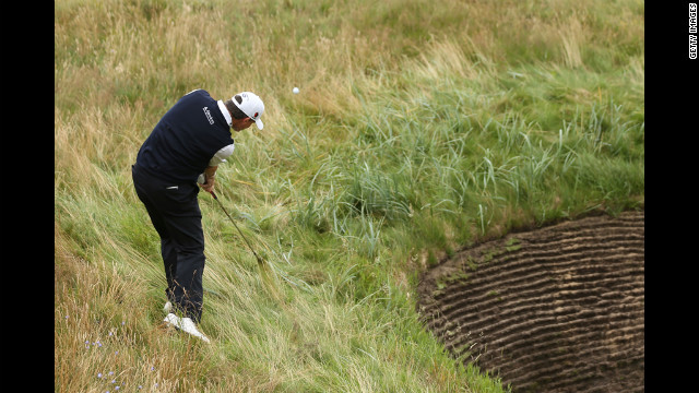 Scottish golfer Paul Lawrie plays a shot from the rough on the eighth hole Thursday.