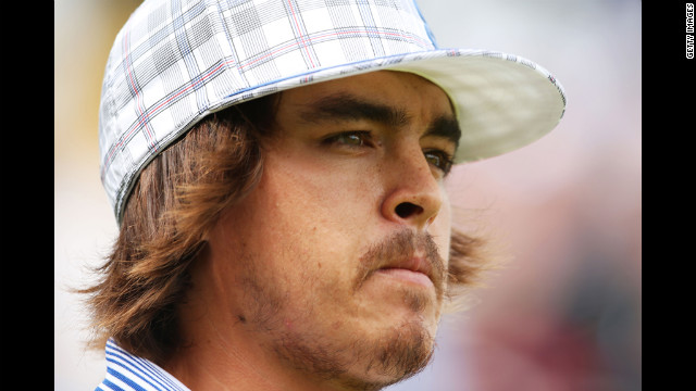 Rickie Fowler of the United States walks off the first tee Thursday.