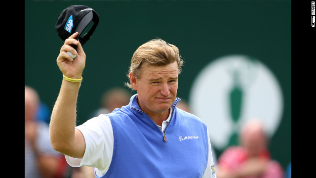 South African Ernie Els waves to the gallery on the 18th hole during the first round Thursday.