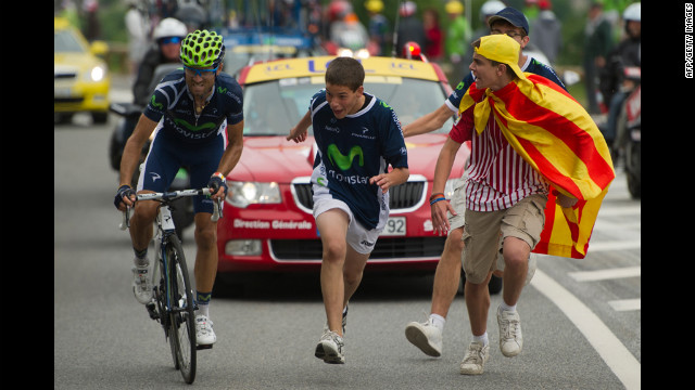 Spectators cheer on Spain's Alejandro Valverde as he rides to victory during the 143.5 kilometer (89 miles) Stage 17, starting in Bagneres-de-Luchon and finishing in the ski resort of Peyragudes, southern France, on Thursday, July 19.