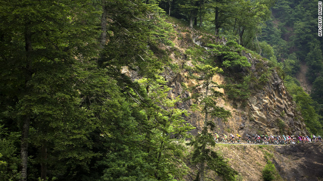 The peloton wind through the narrow mountains rodes of Thursday's race which included several several long difficult climbs on the way to the finish in Peyragudes.