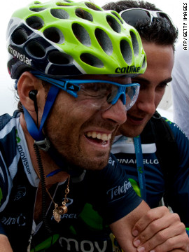 Stage winner Alejandro Valverde of Spain is overcome with emotion after crossing the finish line at the end of the race Thursday.