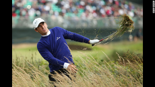 Charles Howell III of the United States plays a shot from the rough on the 14th hole during the first round Thursday.