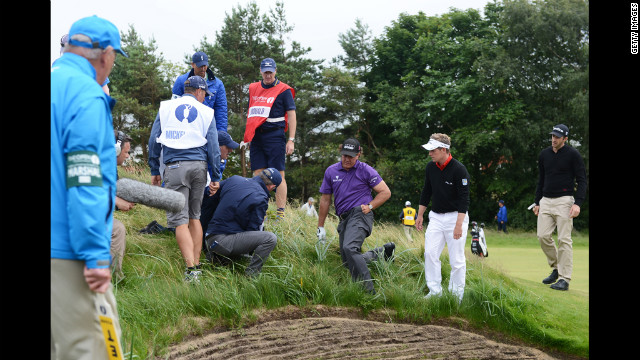 Phil Mickelson of the United States searches for his golf ball on the eighth hole Thursday.