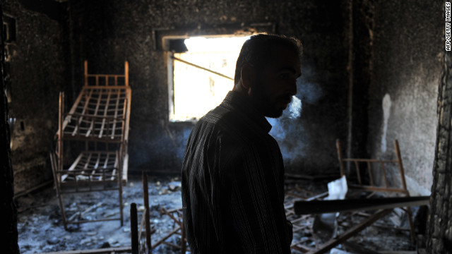 A Syrian man checks the former police station of Syrian regime after a clash at Atareb on Thursday.