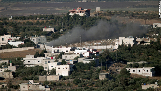 Smoke ascends from from alleged shelling of the Syrian village of Jebata al-Khashab as seen from the hill village of Buqaata in the Israeli-annexed Golan Heights on Thursday.