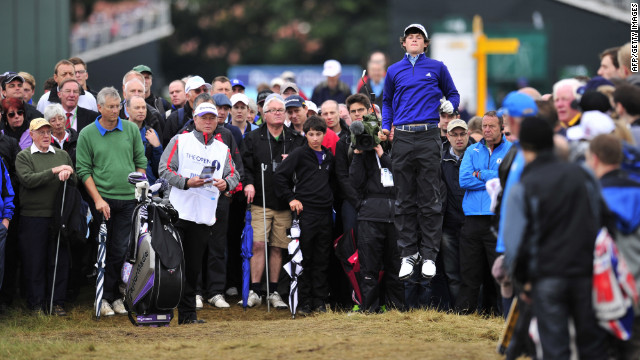 Amateur golfer Alan Dunbar of Northern Ireland leaps up to get a better view on the second hole during the first round of play Thursday.