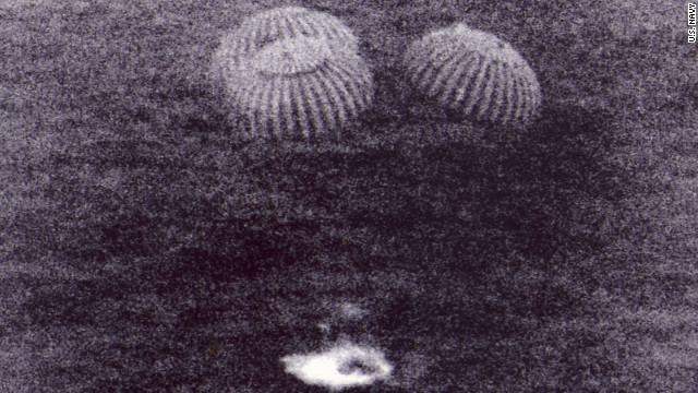 In this U.S. Navy photo, Apollo 11 splashes down about 1,000 miles off Hawaii. It was the exact moment when America achieved President Kennedy's goal to land a man on the moon and return him to Earth, says Scott Carmichael, author of &quot;Moon Men Return.&quot; &quot;It's one thing to get the astronauts to the moon, but you've got to bring them back alive.&quot;