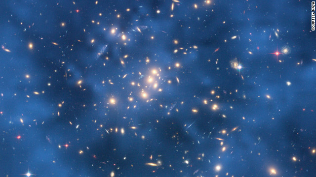 Science on the big scale and the small scale is important for understanding the structure of the universe. The Hubble Space Telescope is looking for indications of dark matter in star clusters, while particle experiments are also hunting down this mysterious substance.