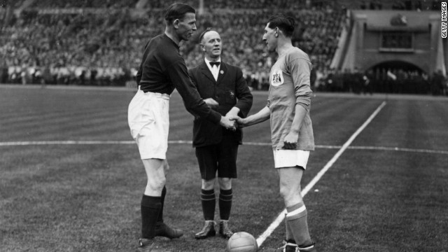 "In 1927, for the first and only time in its history, the FA Cup was taken out of England when Cardiff City (captained by Freddie Keanor, right) beat Arsenal 1-0. The goal scored became known as '""the howler"" but Arsenal goalkeeper Dan Lewis blamed the sheen of his recently-washed jersey for the ball slipping under his body and into the net."