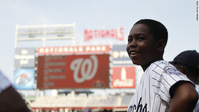 Monarchs second baseman Jahli Hendricks stands at the edge of Nationals Park baseball field in Washington. He and his teammates went on a three-week, 4,000-mile journey for a glimpse at what Jackie Robinson and other players went through during the barnstorming days of the Negro Leagues.
