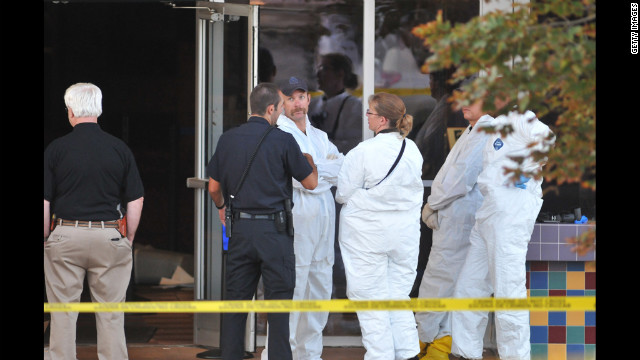 Investigators were a common sight at the theater Friday.
