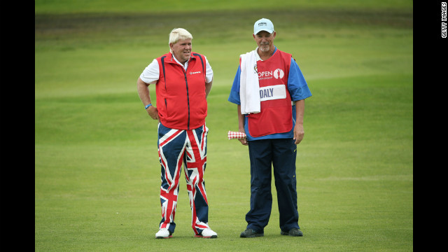 John Daly of the United States speaks with his caddy, Peter Van Der Riet, on the second fairway during Friday's second round.
