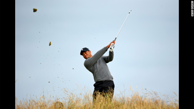 Tiger Woods of the United States tees off on the 11th hole Friday, July 20.