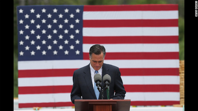 Republican presidential candidate and former Massachusetts Gov. Mitt Romney delivers remarks regarding the shooting in an Aurora, Colorado, movie theater on Friday at a campaign event in Bow, New Hampshire.