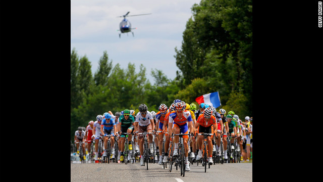 The peloton is chased by a television helicopter on Friday during stage 18.