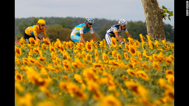 Bradley Wiggins, left, of Great Britain, riding for SKY Procycling, cycles with the peloton Friday.