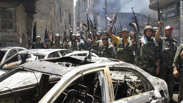 Syrian soldiers celebrate in the al-Midan area in Damascus on Friday. Syrian regime forces routed rebel fighters from the Damascus neighbourhood of Midan, Syrian state television reported, saying troops had