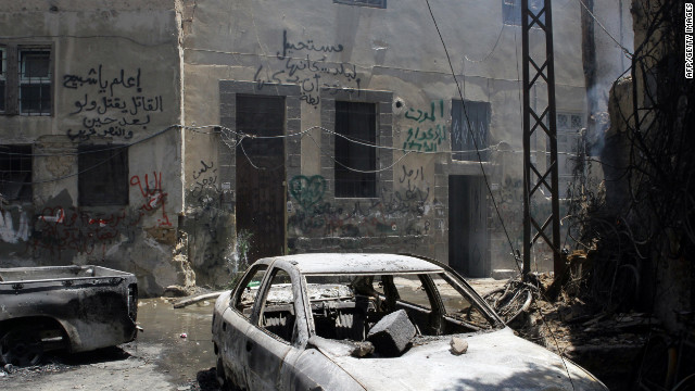 Smoke hangs in the air in a partially destroyed neighborhood in the al-Midan area in Damascus.
